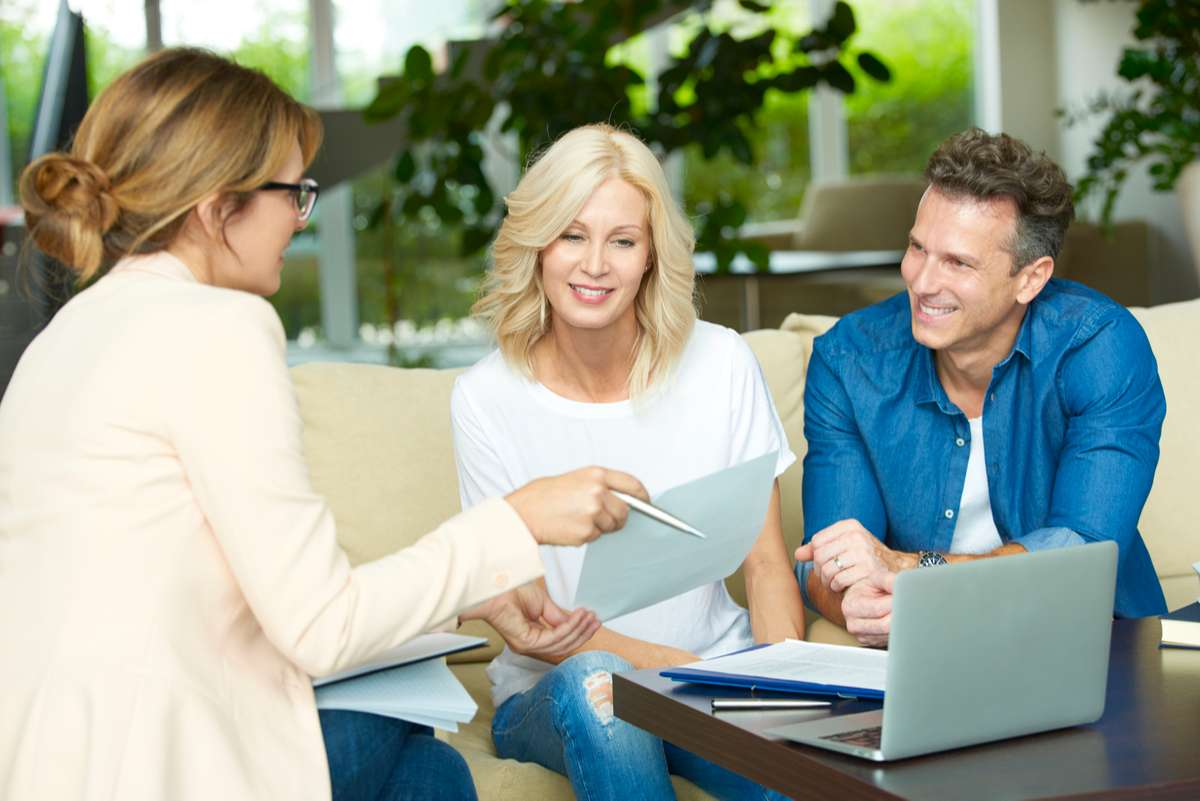 Couple consulting with real estate agent (R) (S)